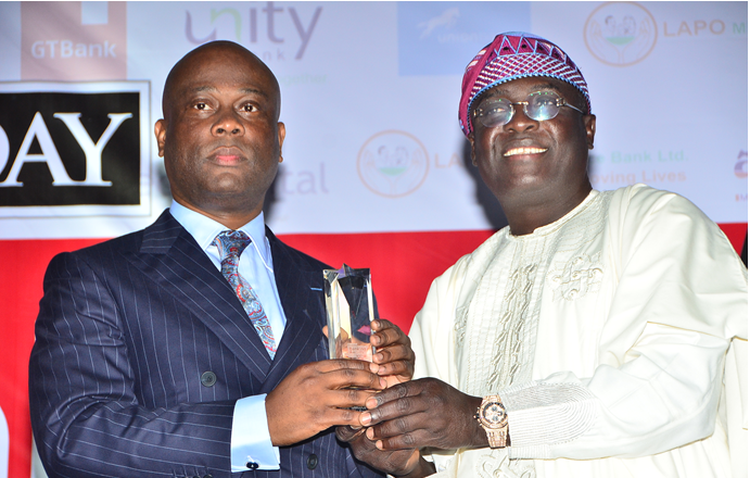 Herbert Wigwe,GMD/ CEO , Access Bank Plc being presented with the CEO of the year award by Femi Pedro, who represented Akinwunmi Ambode, Lagos State Governor