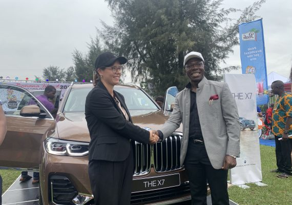 Cosmas Maduka with the representative of German Consulate at the unveiling of BMW X7